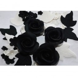Black, white flowers set with roses