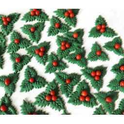 Christmas set with holly leaves with red berries