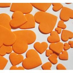 Oranžinės spalvos skirtingo dydžio širdys