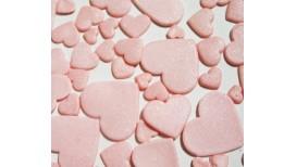Rožinės spalvos skirtingo dydžio širdys blizgančios