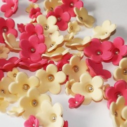 Hot pink, cream blossoms with silver balls