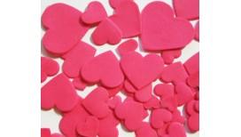 Ryškiai rožinės spalvos skirtingo dydžio širdys