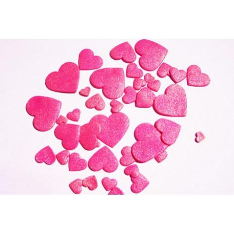 Ryškiai rožinės spalvos skirtingo dydžio širdys blizgančios