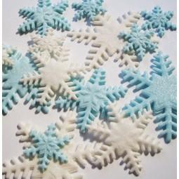 Šviesiai mėlynos, baltos spalvos blizgančios snaigės