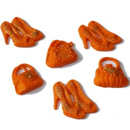 Orange glittering handbags and shoes