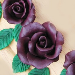 Plush purple chocolate rose